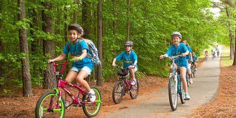 students riding bikes on bike path