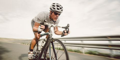 cyclist riding downhill in aero position