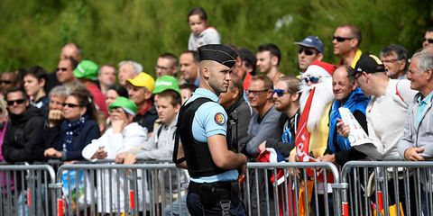 A policeman watching the Tour crowd.