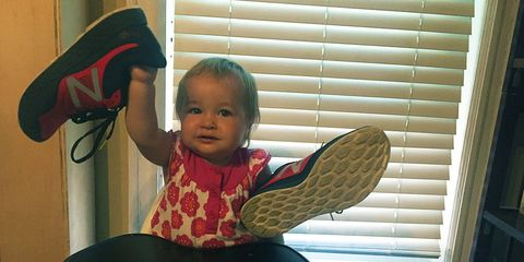 toddler with running shoes