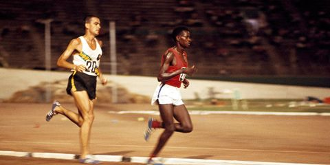 Gold medalist Naftali Temu of Kenya leads silver medalist Ron Clarke of Australia in the 6-mile event during the British Empire and Commonwealth Games in Kingston, Jamaica, on August 6, 1966.