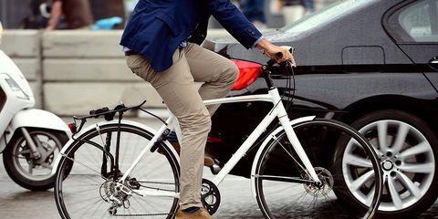 A cyclist riding on a city street.