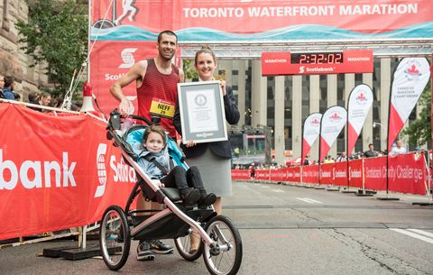 Calum Neff and family after setting stroller marathon record