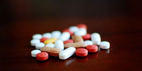 Pills on dark background.