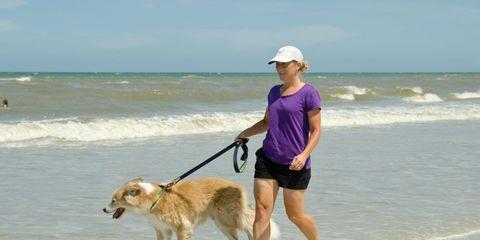 Rebekah Gleason Hope walking dog on the beach