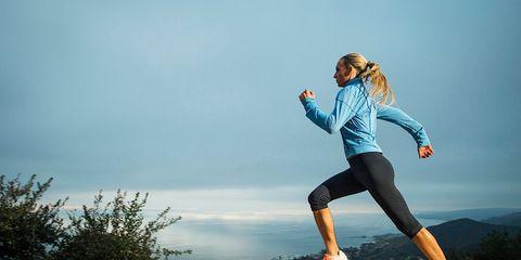 Runner running along a ridge