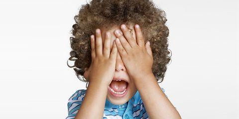 Kid covering his eyes