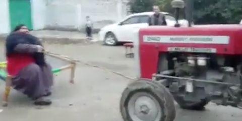 pakistan strongman pulls tractor