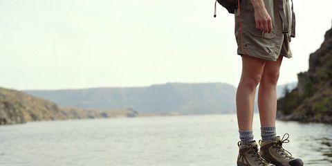 Leg, Human leg, Joint, Coastal and oceanic landforms, Shorts, Bank, Bag, Reservoir, Luggage and bags, Calf,