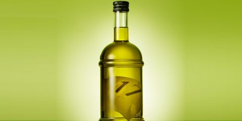 Yellow, Liquid, Glass bottle, Bottle, Fluid, Drink, Amber, Alcohol, Glass, Colorfulness,