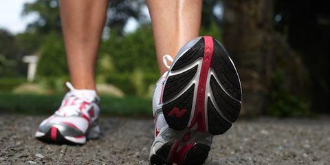 Human leg, Shoe, Athletic shoe, Carmine, Calf, Sneakers, Walking shoe, Sports gear, Symbol, Running shoe,