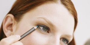 Woman applying eyeliner makeup