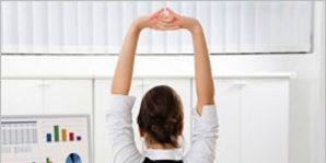 office energy boost: woman stretching