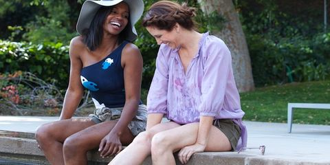Human body, Sitting, Leisure, Summer, Cap, Hat, Vacation, Baseball cap, Outdoor furniture, Outdoor bench,