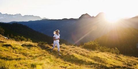 Grass, Mountainous landforms, Grassland, People in nature, Hill, Highland, Sun, Sunlight, Meadow, Mountain range,