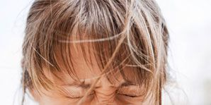 Women with allergies sneezing