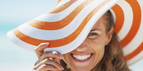 Smile, Skin, Orange, Happy, Facial expression, People in nature, Tooth, Headgear, Beauty, Tan,