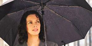 woman holding umbrella in rain