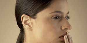 cold sore prevention; woman touching her face