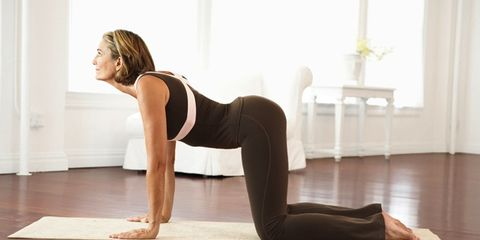 yoga for pain; woman stretching