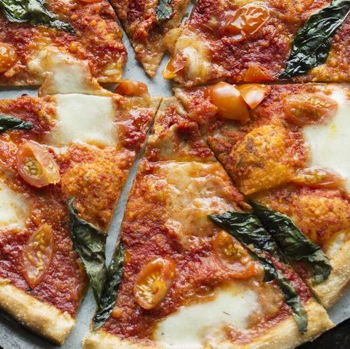pizza with basil and tomatoes