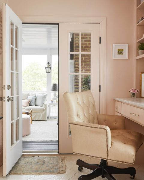 home office, pink painted walls, office chair with wheels, marble countertop