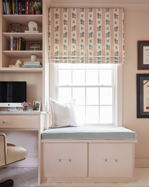 home office, pink painted walls, pink storage, blue window seat cushion