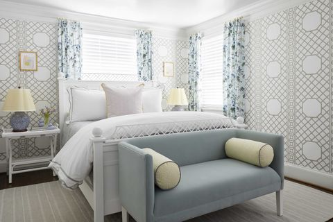guest bedroom, blue seat, blue and white floral curtains