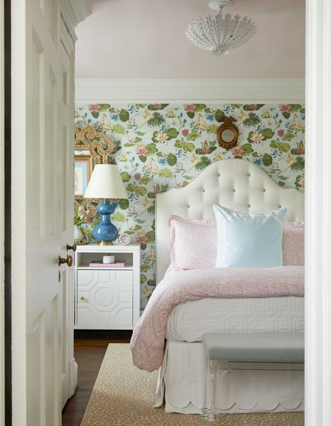 hguest bedroom, pink and white linen, white bedside table, floral wallpaper