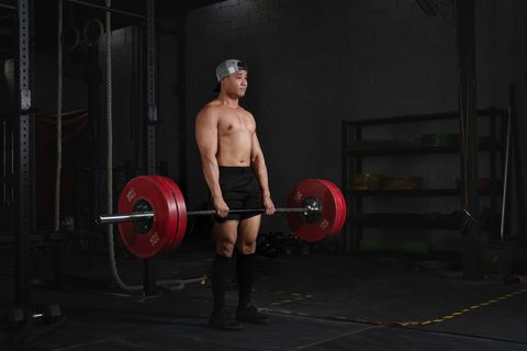 asian bodybuilder athletic man having bodybuilding with barbbells weight lifting in gym and fitness health club