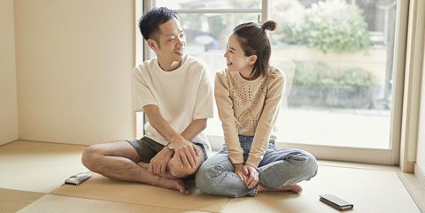 asian couple relaxing in the japanese style room at home