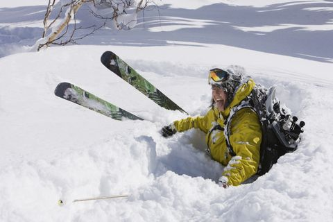 Asian falling in snow