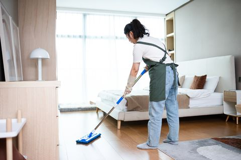 asian female Cleaning Floor With Mop