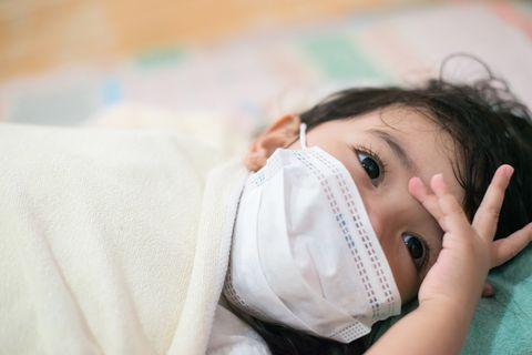 asian little child girl feeling headache illness,sickness concept