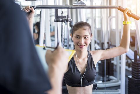 asian woman workout with her trainer in gym, personal training concept