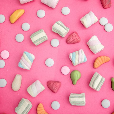 asorment of candies and sweets in pink background