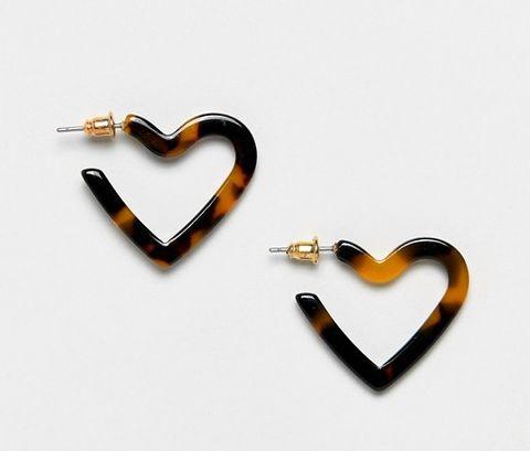 Heart, Body jewelry, Fashion accessory, Jewellery, Earrings, Heart, Locket, Metal,