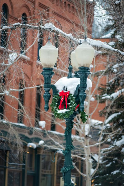 aspen colorado street lamp closeup with snow and holiday decorations