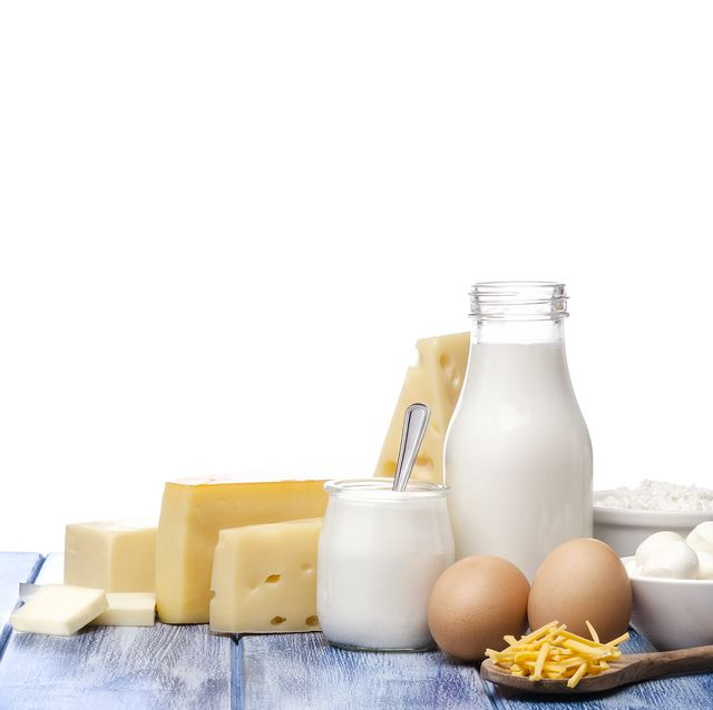 assortment of dairy products shot on blue striped table against blue striped table
