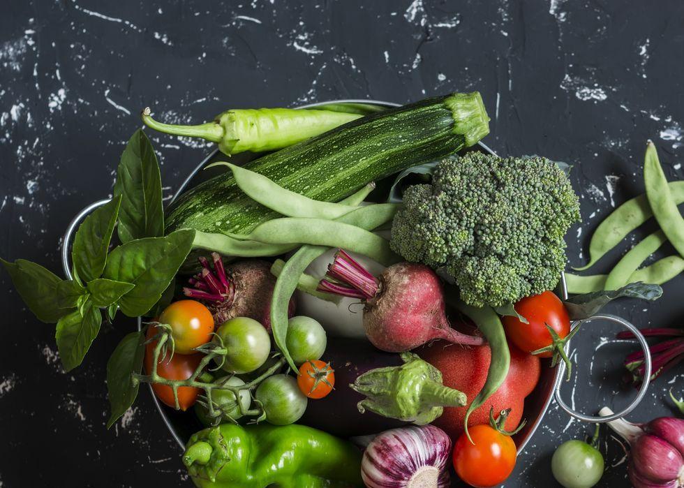 Assortment of fresh vegetables in a metal basket