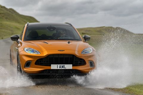aston martin dbx takes on stream, wins