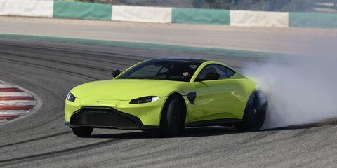 Land vehicle, Vehicle, Car, Sports car, Automotive design, Performance car, Yellow, Sports car racing, Supercar, Coupé,