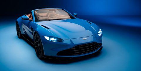 Automotive design, Car, Fender, Logo, Hood, Headlamp, Performance car, Sports car, Personal luxury car, Azure,