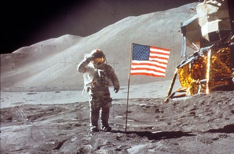 astronaut david scott salutes by us flag