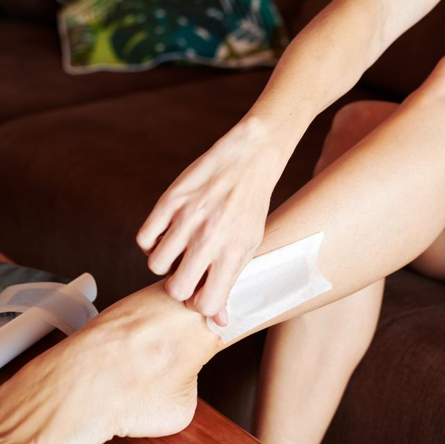 woman waxing lets at home