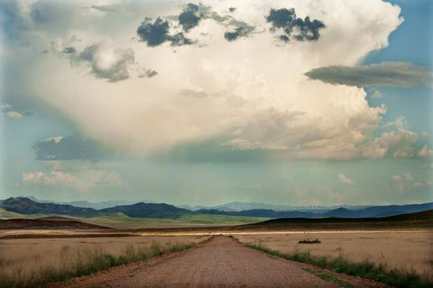 western sky, clouds, empty road