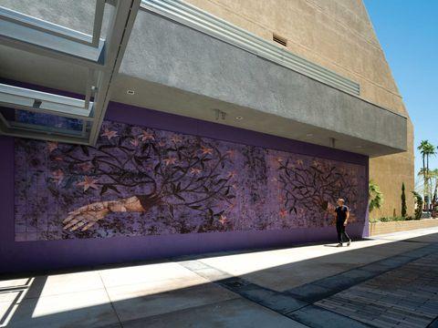 felipe baeza's mural finding home in my own flesh adorns a palm springs wall as part of the desert x biennial