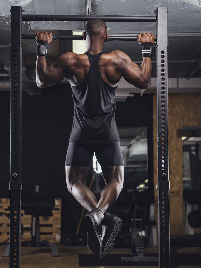 athlete doing push ups in gym