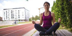 Athlete girl meditate
