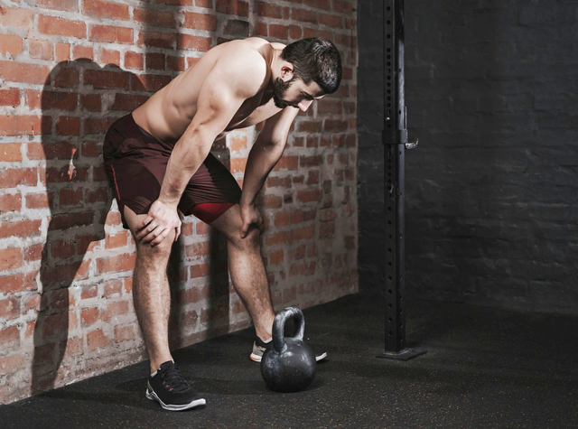 athlete leaning against the wall at the gym